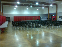 Shannon Hall red drape + 250 chairs far